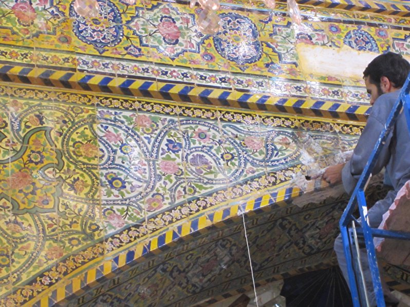 Applying tile-work in the middle ring of the shrine of Imamain Al-Javadain(peace be upon them)